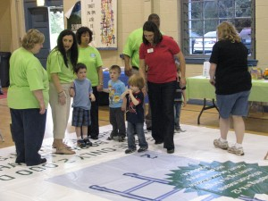 The Partnership and PAT staff played Chutes and ladders with children at the MomsRising event.